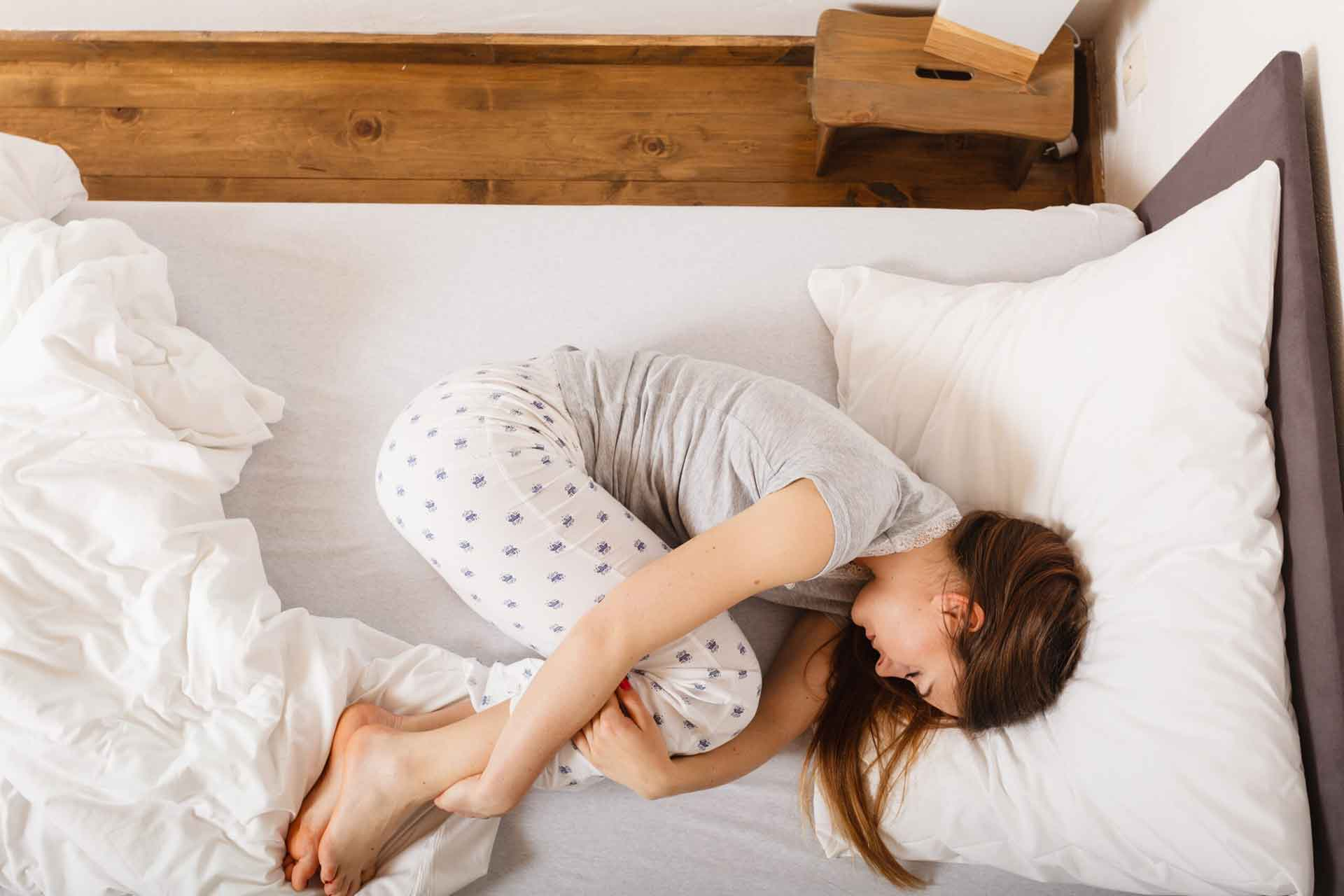 best-sleeping-positions-for-lower-back-pain
